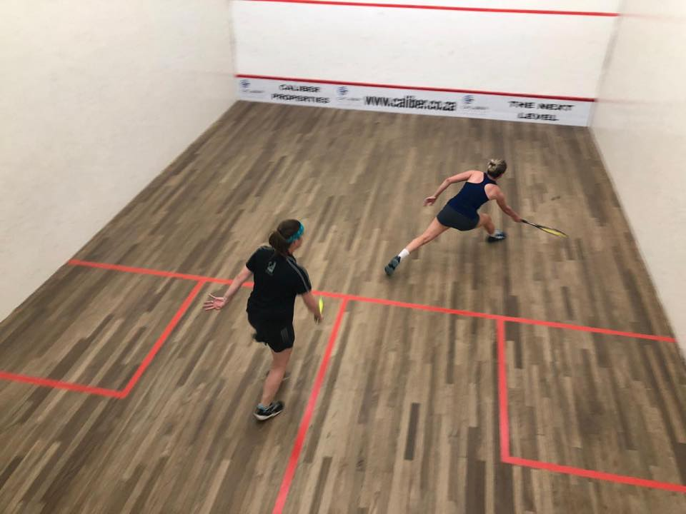 Amy Farreel and cornelie read playing squash