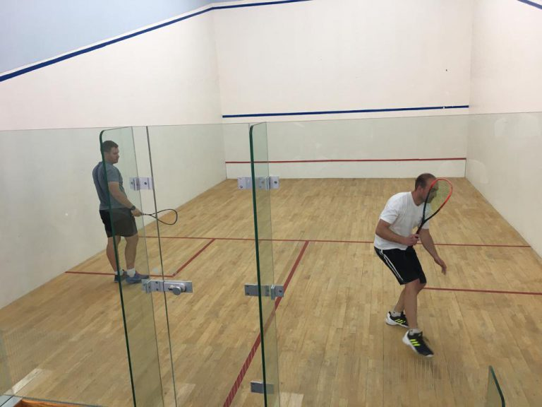 Tyronne playing a drive down the wall at the mielieland squash tournament